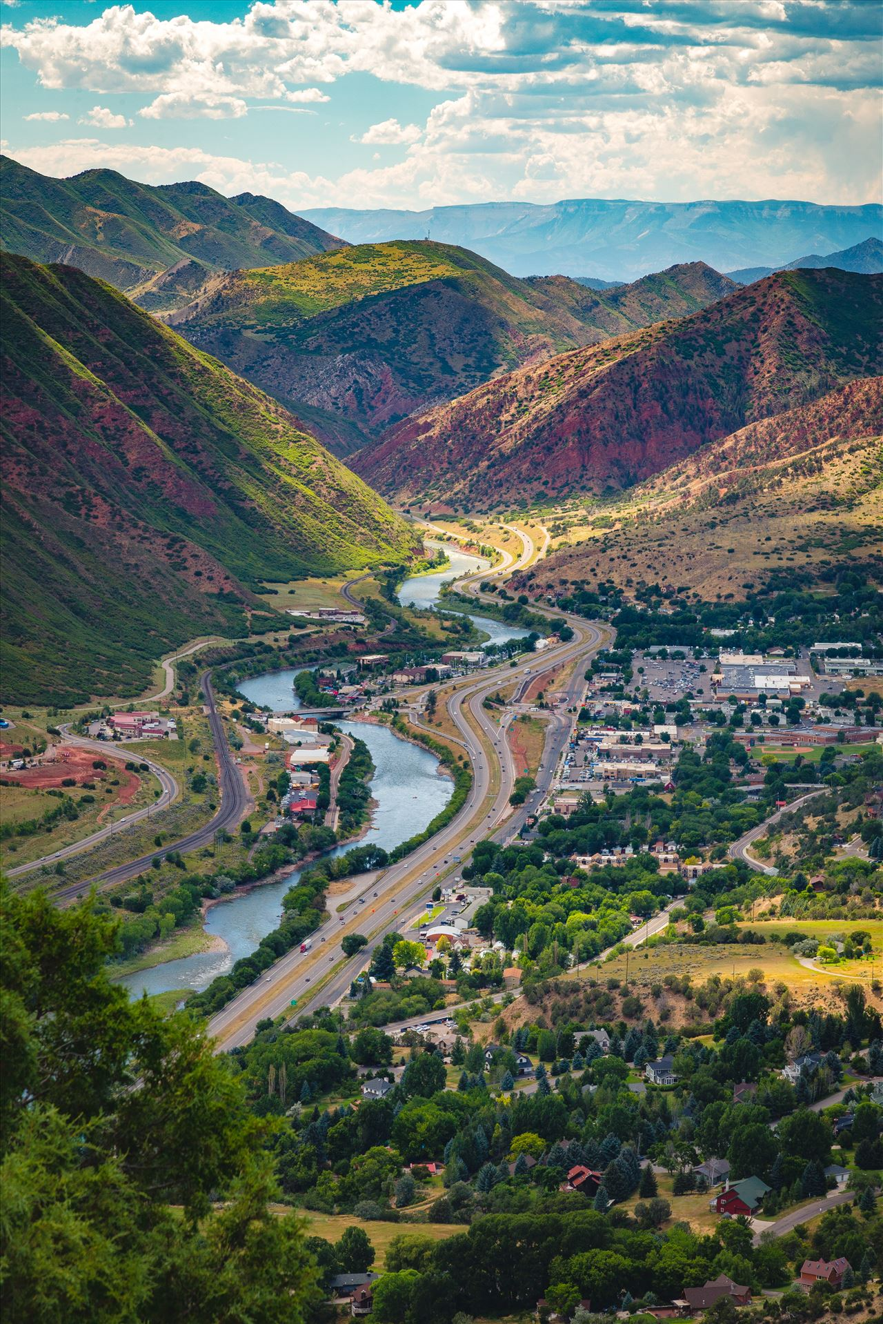 Glenwood Springs from Glenwood Caverns No 1 - Looking down from the top of Glenwood Caverns, the city of Glenwood Springs, Colorado looks miniature. by Scott Smith Photos