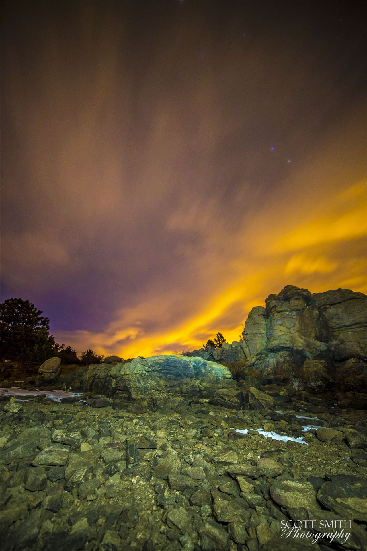 Night Sky on Fire at Mary's Lake - Clouds lit from distant Boulder and Denver light the sky at midnight.  From the shore of Mary's Lake a few miles near Estes Park, looking east towards Denver. by Scott Smith Photos