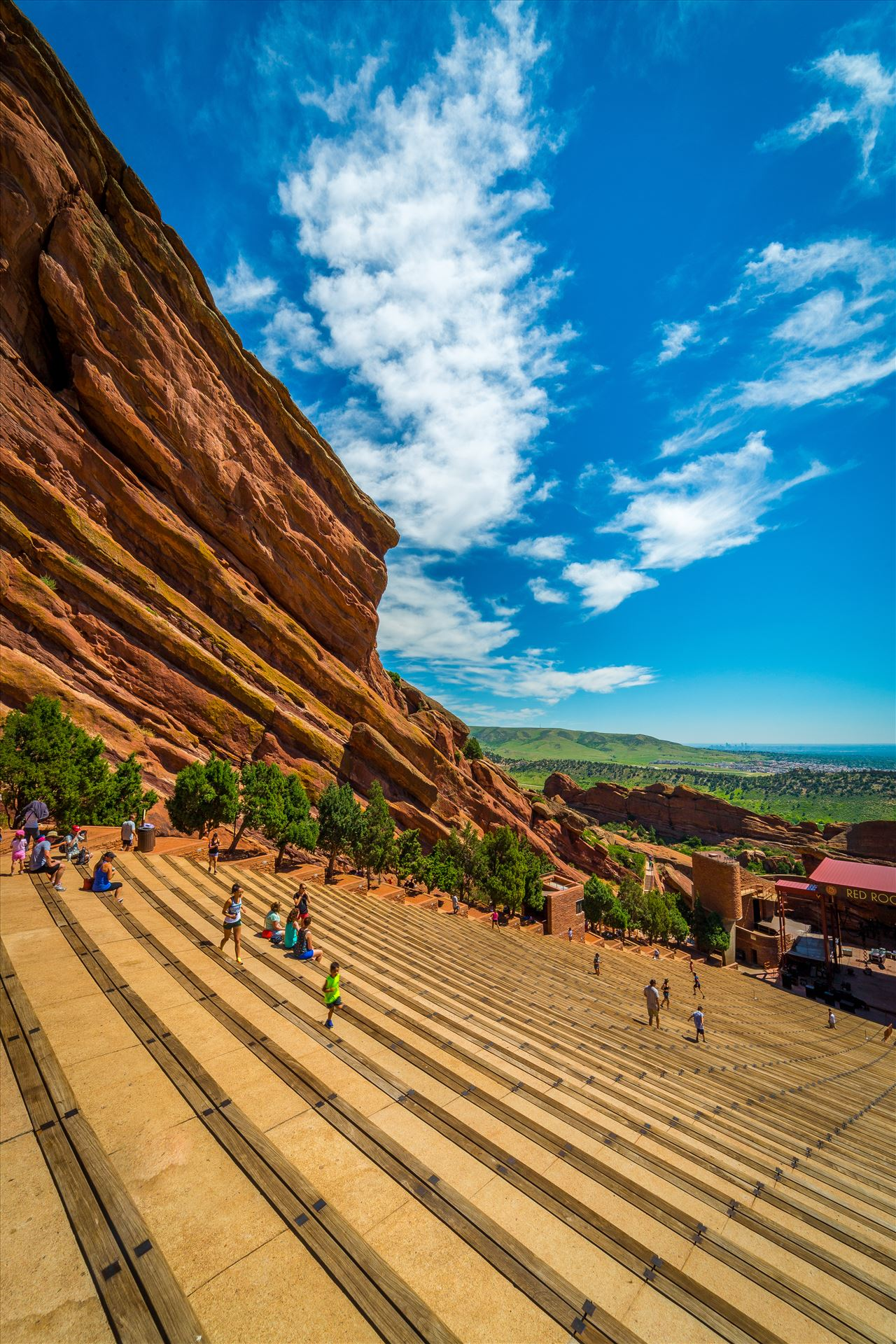 Red Rocks Amphitheater - People getting a workout at Red Rocks amphitheater on a warm Sunday morning. by Scott Smith Photos