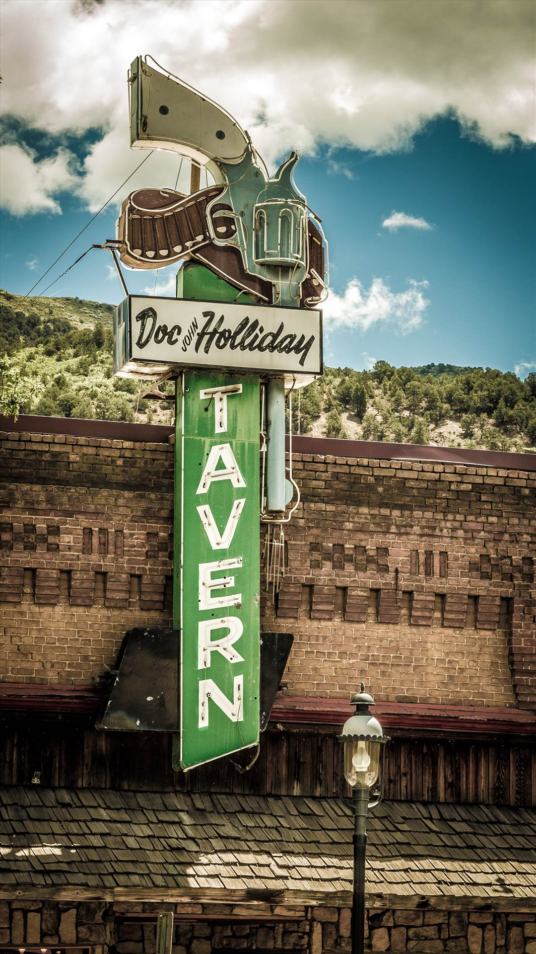 Doc Holliday Tavern in Glenwood Springs - The famous sign for the Doc Holliday Tavern in Glenwood Springs by Scott Smith Photos