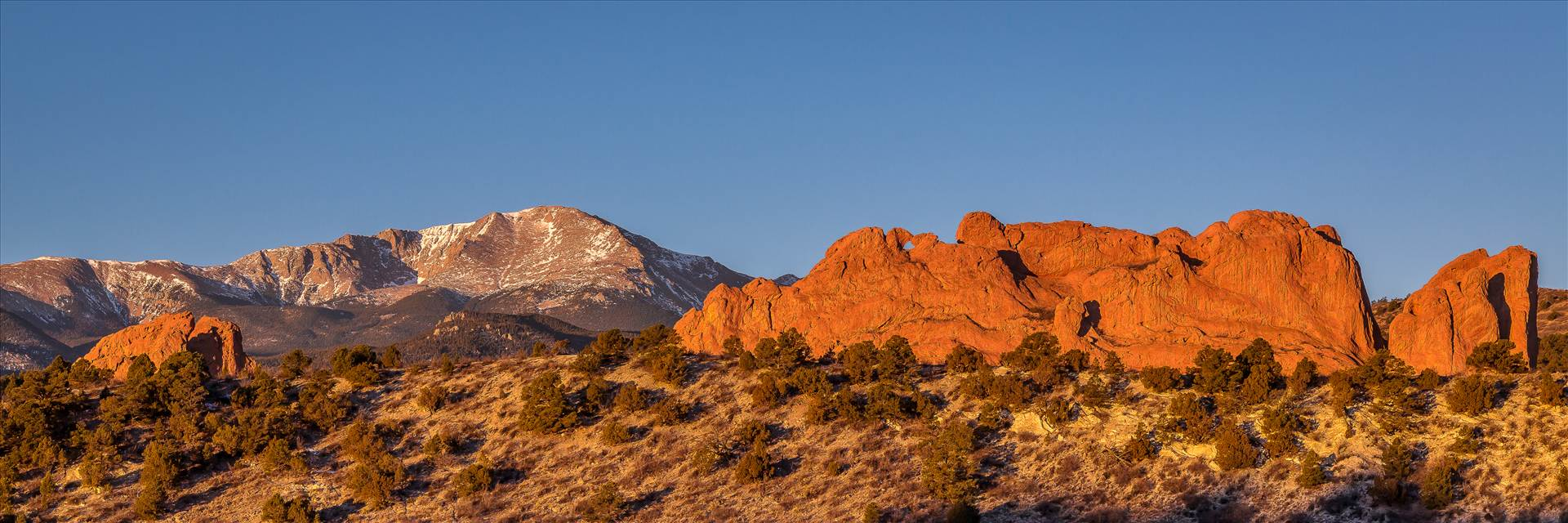 Garden of the Gods Sunrise - The Garden of  the Gods with Pike's Peak in the distance. by Scott Smith Photos