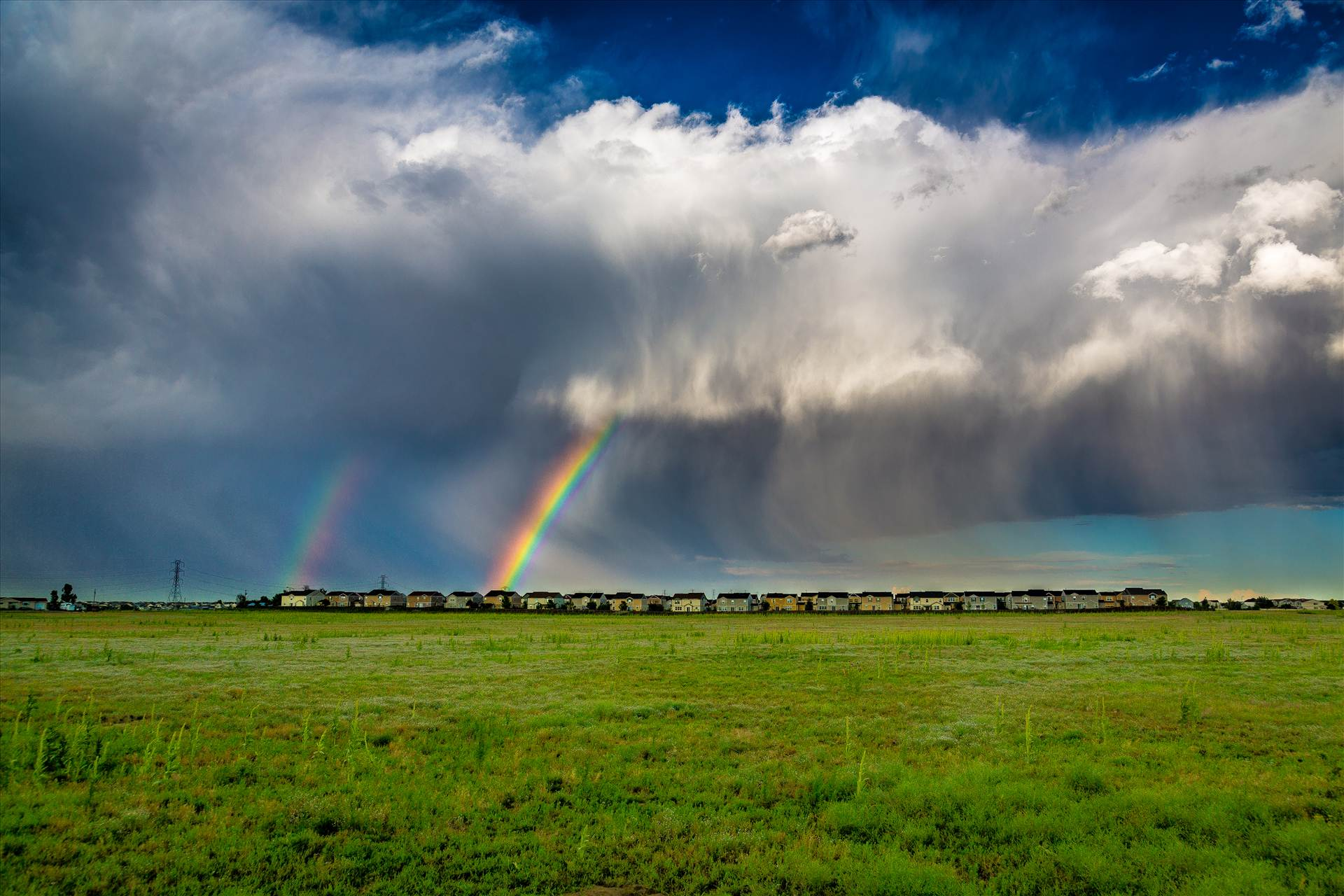Suburbia Rainbow Connection - A double rainbow breaks through some clouds east of Denver. by Scott Smith Photos