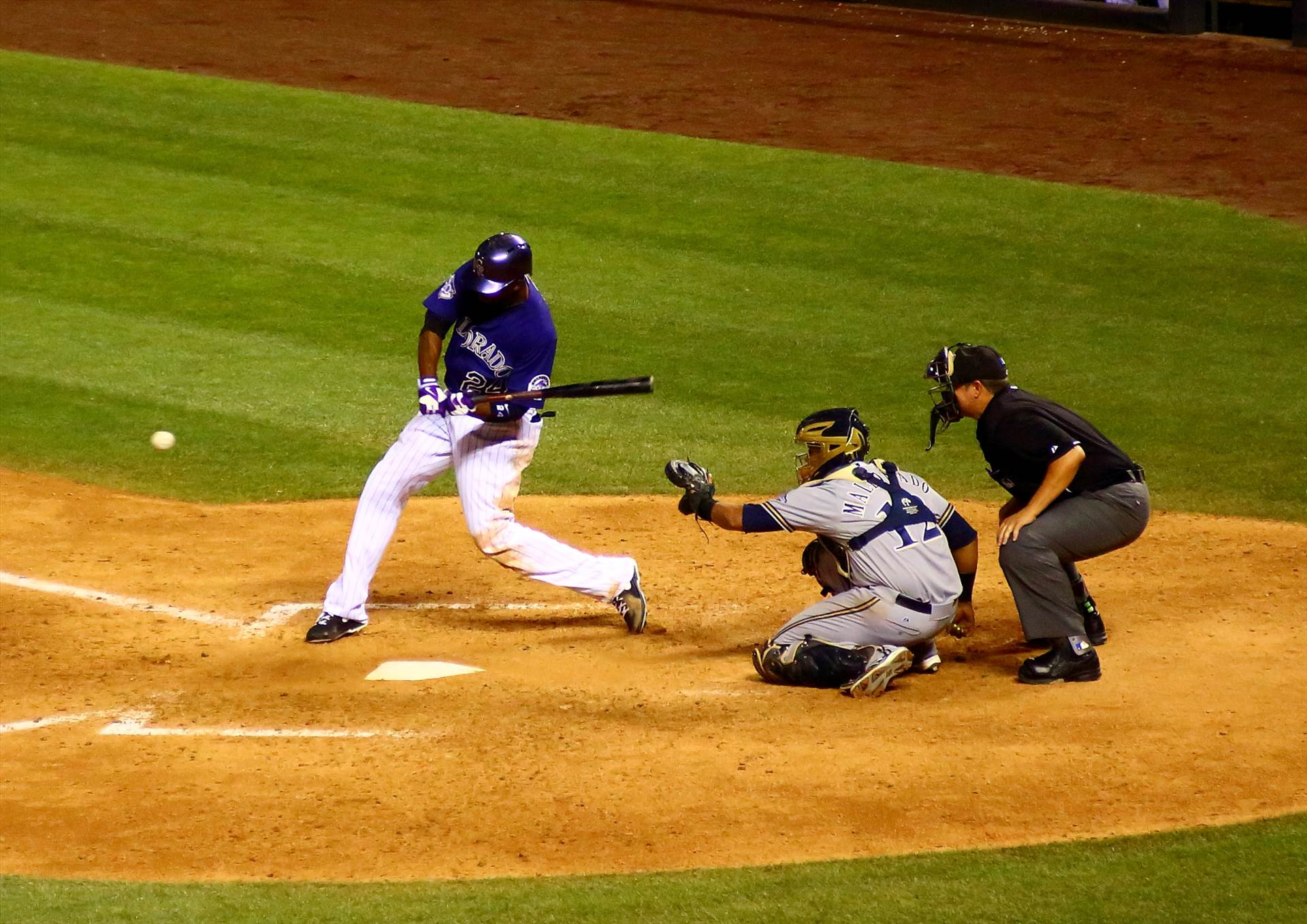 The Rockies Swing Away -  by Scott Smith Photos