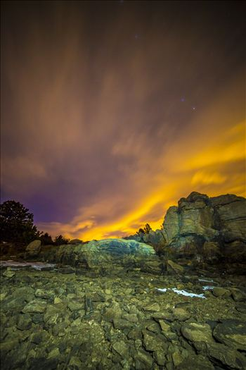 Clouds lit from distant Boulder and Denver light the sky at midnight.  From the shore of Mary's Lake a few miles near Estes Park, looking east towards Denver.