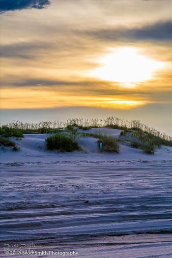 The sun sets over the sand dunes on the outer banks in North Carolina.