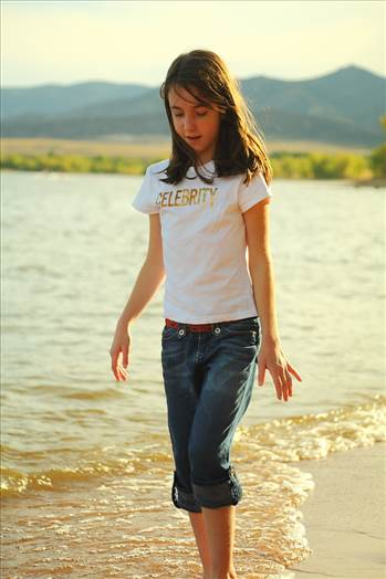 My daughter wwlking on the beach at Chatfield Resevoir, CO.